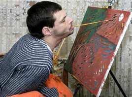 Foto Libro Artistas Contemporaneos - Francisco Javier Planells Alós becario de la asociación Artistas pintores con la boca y el pie